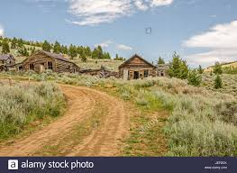 abandoned homes along a dirt road in an old mining town which is