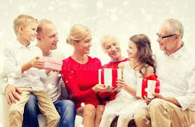 smiling family with gifts at home stock photo image 61010994