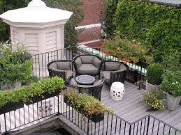 garden design ideas the layered behind white stone barn below deck