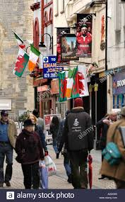 welsh and irish flags hanging outside the old arcade pub on a