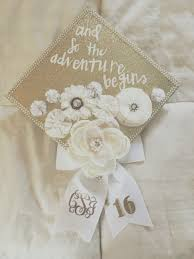 Monogrammed Scrapbook Graduation Cap Decorated With White Faux Flowers Pearls And Gold
