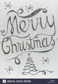 merry lettering with black chalk on white board