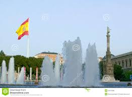 Christopher Columbus Flag Water Fountain And Spanish Flag Waves Behind Statue Of Christopher