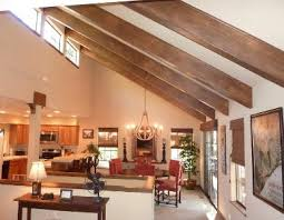 half vaulted ceiling with beams sky lights between beams rather