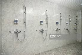 public shower room with soap dispensers on wall stock photo