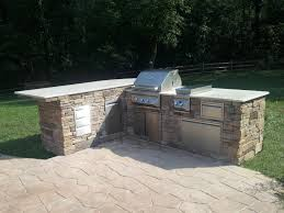 custom outdoor kitchen with grill side burner paper towel holder