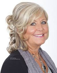 naturally curly gray hair medium long curly hairstyle for aged women with grey hair with