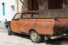 rusty pickup truck rusty pick up truck battered old automobile stock photo picture