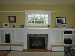 interior white fireplace with white tile surround and black