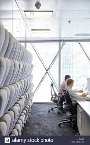 padded movable sound proof walls and office workers at desks