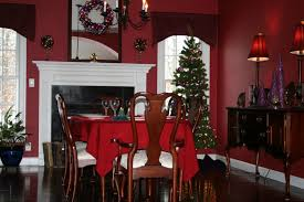 christmas dining room table decorations in front of fireplace with