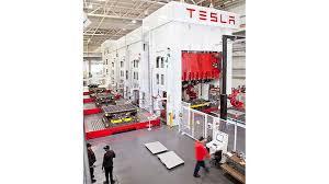 tesla loses 330 million in first quarter model 3 production