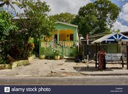 barbados wooden houses street bus stop woman waiting for bus
