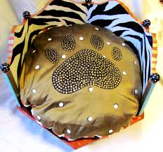 hand painted round dog beds made from an end table in zebra and