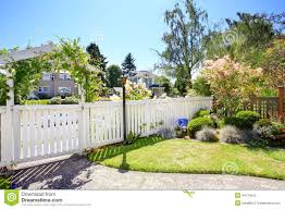 front yard with white fence and landscape stock photo image