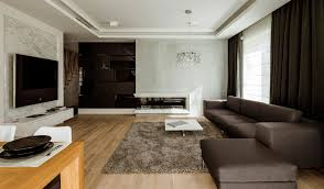 Led Tv Table 2015 Brown Sofas Facing White Table Beside Th Led Tv In The Apartment