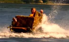 video dude goes water skiing on a couch inhabitat green