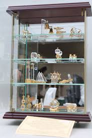 a small display cabinet containing a collection of
