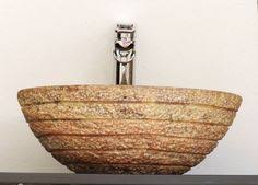 chiseled round red travertine vessel stone sink rustic bathroom