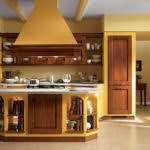 Kitchen Yellow - kitchen yellow cabinets in the kitchen with a refrigerator and a