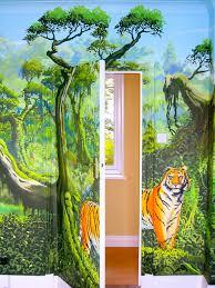 rainforest wall mural bedroom inspired jungle stickers amazon animal themed bedroom ideas jungle room accessories boy reading in decorated like fantasy oscar hanna wall safari