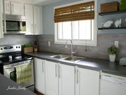 kitchen contractors long island kitchen patterned tile backsplash dark grey countertops cabinets