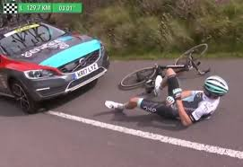 watch tour of britain rider crashes after being bumped by rival
