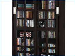 Cd Storage Cabinet With Doors by Dvd Cabinet With Glass Doors