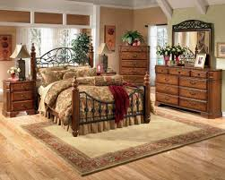 charming country bedroom with dark wood furniture and iron wrought