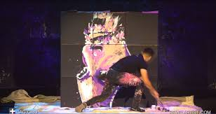 upside down speed painter wows audience with incredible painting