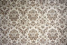 vintage wallpaper with brown ornaments stock photo picture