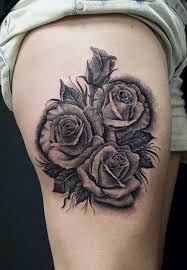 three grey and black roses on side thigh
