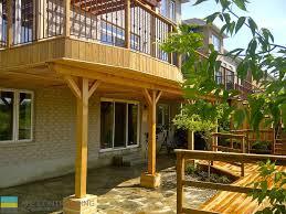 pressure treated and cedar deck with stone veneer pressure