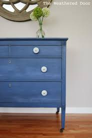 a federal blue milk paint dresser with light blue knobs the