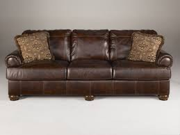 ashley leather sofa set ashley furniture axiom walnut sofa the classy home