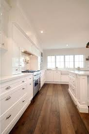 white kitchen wood floors fitbooster me
