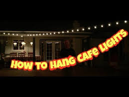 how to string cafe lights how to hang outdoor cafe lights or string lights on a wire youtube