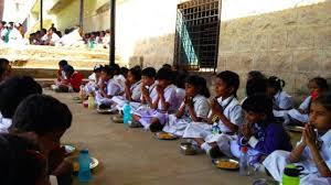 children from an underprivileged school in india pray and are