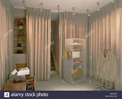 Curtains For Dressing Room Spotlights Above Perspex Shelving In Dressing Room With Beige