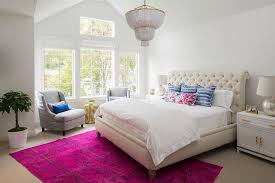 cream tufted sleigh headboard with pink overdyed rug