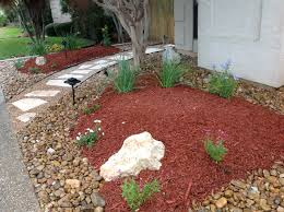 rocks against paths bark mulch in planting area stepping stones