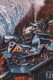 the village of hallstatt austria looks very warm and cozy nestled