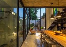 huge glass doors open mexican house to a courtyard garden glass