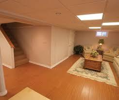 How To Finish Basement Floor - beautiful wood laminate basement flooring in ny wood finish