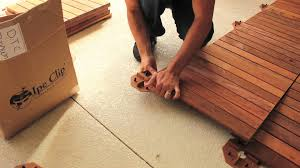 Laminate Flooring Over Concrete Slab How To Install Deck Tiles Over Concrete Youtube