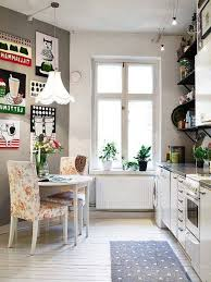 serene small vintage kitchen with full print wallpaper and small
