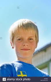 boys light blue tie close up portrait of a swedish boy smiling against light blue sky