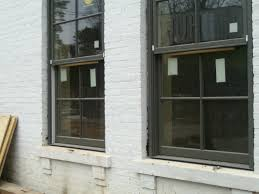 Pella Outswing French Patio Doors by Black Pella Windows Matched With White Bricked Wall Ideas Window