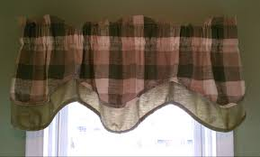 window valance with black and pink plaid pattern in white window
