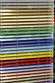 metallic aluminum blinds in all rainbow colors stock photo